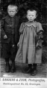Two-children-with-note-that